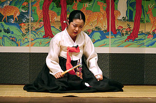 """Pansori performance at the Busan Cultural Center"" by Steve46814 - Own work. Licensed under CC BY-SA 3.0 via Wikimedia Commons."
